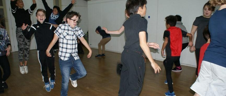 Photo of a group of school children dancing