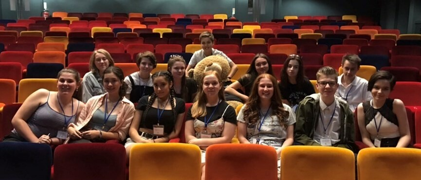 A photograph of a group of previous Playhouse work experience students sitting in the auditorium.
